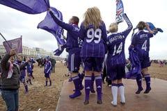People waving team flag. People on the beach in Belgium waving their team flag royalty free stock photos