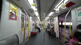 People wear mask in public transport LRT. This is compulsory during COVID-19