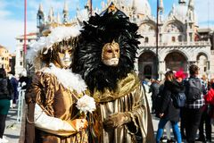 People wearing carnival masks at traditional Venice Carnival