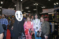 People wearing costumes from Anime movie Spirited Away at NY Com. NEW YORK, NEW YORK - OCTOBER 9: People wearing costumes from anime movie Spirited Away at NY Royalty Free Stock Photo