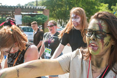People Wearing Elaborate Zombie Makeup Walk In Atlanta Pub Crawl. Atlanta, GA, USA - July 25, 2015: A horde of bloody zombies stagger to nearby bars as part of royalty free stock photos