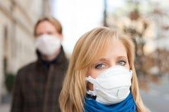 People Wearing Flu Protection Masks Stock Photo