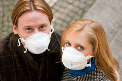 People Wearing Flu Protection Masks Stock Image