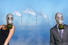 People wearing gas mask on factory background. Business people wearing gas mask on the pollution air and factory background royalty free stock images