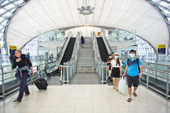 People wearing mask protection at the airport Royalty Free Stock Photos