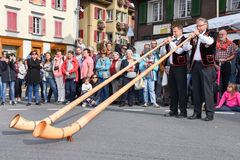 People wearing traditional clothes and playing the alphorn at Ke Royalty Free Stock Images