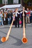 People wearing traditional clothes and playing the alphorn at Ke Stock Images
