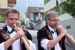 People wearing traditional clothes and playing the alphorn at Ke Stock Photos
