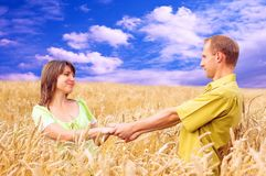 People in wheat field Stock Image