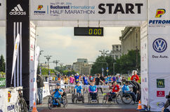 Athlets in wheelchairs at starting line Royalty Free Stock Photos