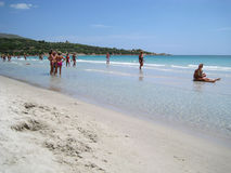 People in white beach with blue crystal sea in summertime at Cap. Itana as editorial royalty free stock image