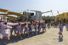 People in white dresses on the Japanese traditional parade on EXPO 2015 Royalty Free Stock Photo