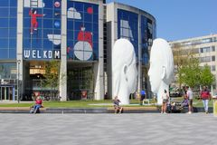 Leeuwarden, Netherlands, May 5 2018, People modern artistic white faces statues arts by Jaume Plensa. People relax around two white statues of male and female stock image