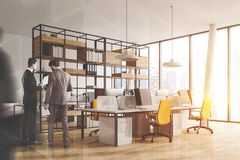 People in white open space office corner royalty free stock photography