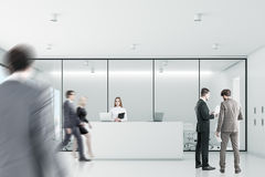People white reception, front. Businesspeople are wallking past a reception with white walls meeting room in the background. 3d rendering Royalty Free Stock Images