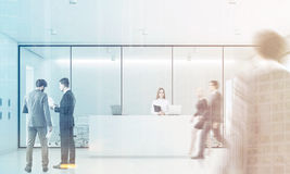 People white reception, front, toned. Businesspeople are wallking past a reception with white walls meeting room in the background. 3d rendering, toned image Stock Photography