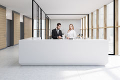 People at white reception in glass office Stock Images