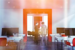 People in white and red open space office royalty free stock photography