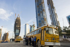 The people who constructed dubai. Workers waiting at the bus in the construction place in dubai Stock Image