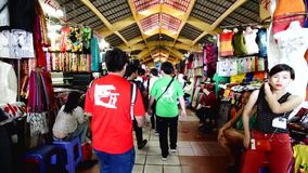 People who are shopping at Ben Thanh Night Market in Ho Chi minh. SAIGON, VIETNAM - NOVEMBER 01 : people who are shopping at Ben Thanh Night Market on November stock video footage