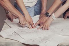 People who work with drawings on the table. In the white room royalty free stock photos