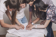 People who work with drawings on the table. In the white room royalty free stock images