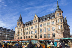 People at the Wiesbaden Farmers' Market. WIESBADEN, GERMANY - JAN 28, 2009: people enjoy the extensive range of produce, the inviting atmosphere and the Royalty Free Stock Image