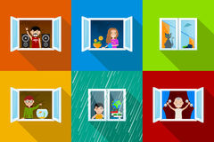 People In Windows. Different people in city building windows, young rock music fan with speakers, girl with flowers, spoiled cat, boy feeding fish, bored girl Royalty Free Stock Photography