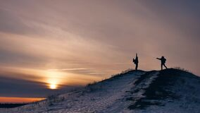 People winter jumps silhouette photograph joy snow sunlight. group of tourists walking on top of a sunset silhouette. People winter jumps silhouette photograph stock footage
