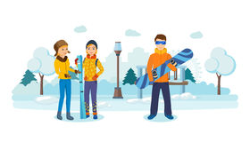 People in winter park, with skis in hands and snowboard. Royalty Free Stock Photos