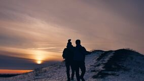 People winter silhouette does selfie photograph joy snow sunlight. group of tourists walking on top of a sunset. People winter silhouette does selfie photograph stock video footage