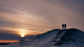 People winter silhouette does selfie photograph joy snow sunlight. group of tourists walking on top of a sunset. People winter silhouette does selfie photograph stock video