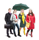 People  in wintry clothes with bag Stock Images