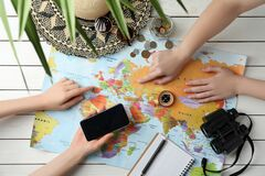 People With World Map And Accessories At Table. Travel During Summer Vacation Royalty Free Stock Photography