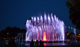 People wondering colourful fountain royalty free stock image