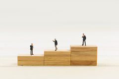 People on wood block Royalty Free Stock Photography