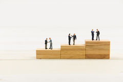 People on wood block Royalty Free Stock Images