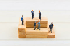 People on wood block Stock Images