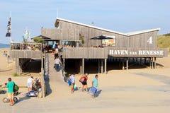 People walking wooden beach restaurant sea, Renesse, Zeeland, Netherlands