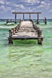 People on a wooden pier. People talking on a wooden pier and swimming in the sea, Playa del Carmen, Mexico Royalty Free Stock Photo