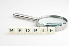 People word and magnifying glass Royalty Free Stock Photos