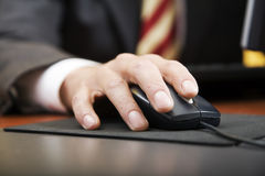 People at work. Close-up of a businessman's hand using a mouse Stock Photo