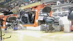 People work at assembly of cars Lada on conveyor of factory AutoVAZ stock video