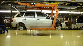 People work at assembly of cars Lada Kalina on conveyor of factory AutoVAZ stock video footage