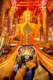 People work with cloth on Buddha image in Wat Phanan Choeng temp. AYUTTHAYA, THAILAND - FEB 24: People work with cloth on Buddha image in Wat Phanan Choeng stock images