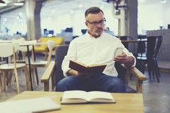 People at work creating article about literature stock photo