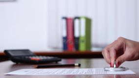 People work with documents and stamp. Close up stock footage
