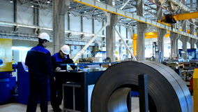 People at work in the Joint venture enterprise Severstal-SSC-Vsevolozsk stock video footage