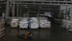 People work in large warehouse with goods at factory. VOLZHSKY, Russian Federation - OCTOBER 27, 2014: People work in large warehouse with goods at factory stock video footage