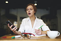 People at work latest news using smartphone stock image